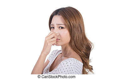 bad smell face - Portrait of a young woman holding her nose...