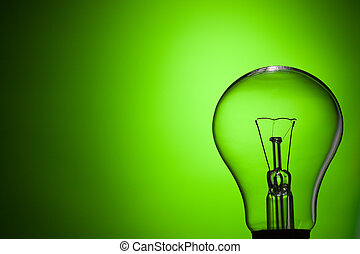 light bulb on green background - photo shot of light bulb on...