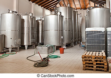 Wine Fermenting in huge vats in a wine cellar. Shoot in...