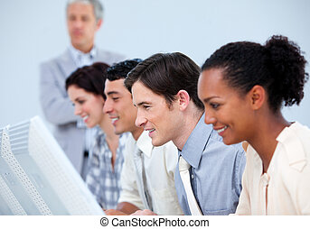 Concentrated business people with their senior manager at...