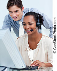 Charming business partners working at computers