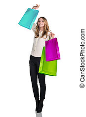 Woman in formal wear with colorful packages isolated on...