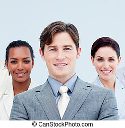 Smiling business people standing with folded arms - Smiling...