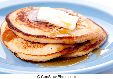home made pancakes - stack of pancakes with syrup and melted...