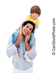 Smiling father having fun with his son against a white...