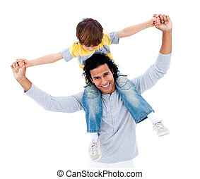 Cute little boy on his fathers shoulders against a white...