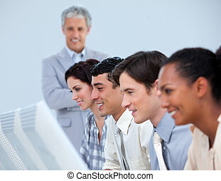 Positive business people with their senior manager at work