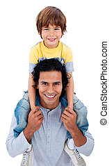 Happy little boy on his father\'s shoulders against a white...
