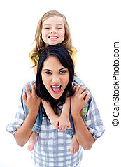 Joyful mother giving piggyback ride to her daughter isolated...