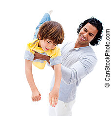 Cheerful father having fun with his son against a white...
