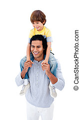 Joyful father giving piggyback ride to his son isolated on a...