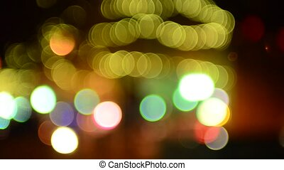 out of focus lights bokeh in an evening of a busy city -...