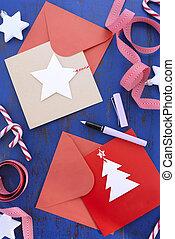 Writing Christmas Cards on Blue Table. - Writing Christmas...