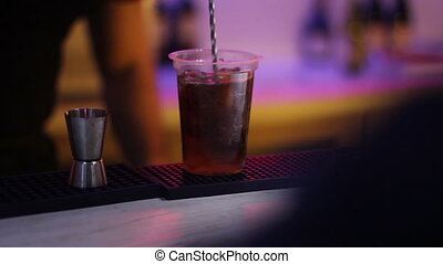 rum cola with ice on bar
