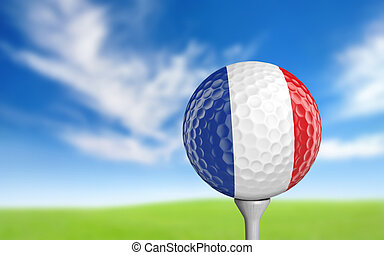 Golf ball with France flag colors sitting on a tee