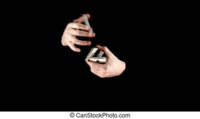 Magician go on showing his trick with cards, cardistry on...
