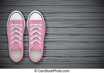 Pink gumshoes Shoes on wooden background
