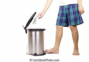 School boy keep clean put tissue paper in rubbish bin -...