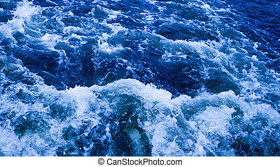 blue water bubbling and foaming - clear blue water flows...