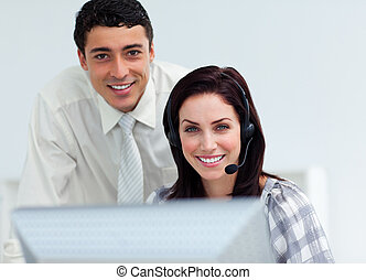 Blissful manager checking his employee\'s work