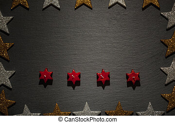 Four red star candles on slate with star frame - Four red...