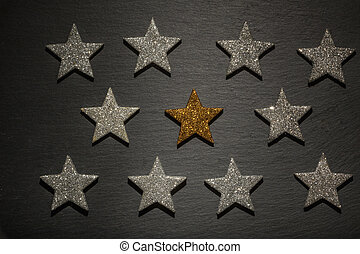 Silver and one golden stars in row - Silver and one golden...