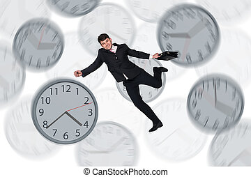 Businessman running late with among big clocks - Full length...