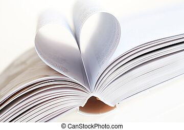 I love books - Detail of open book with heart shape,...