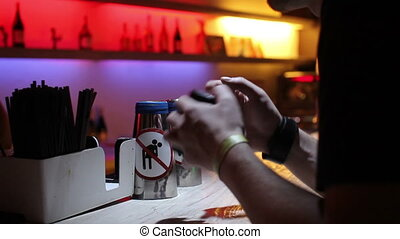 man orders a drink at the bar