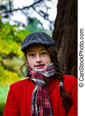 Cute teenage girl autumnal portrait in the park