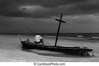 Unidentified old man on wereck boat on the beach with storm...