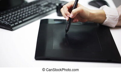 female hand drawing with stylus on pen tablet - business,...