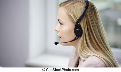 businesswoman with headset talking at office - business,...