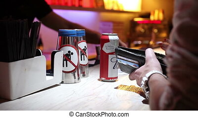 can of beer on bar - man taking can of beer on bar