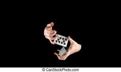 Talanted magician starts showing his trick with cards,...