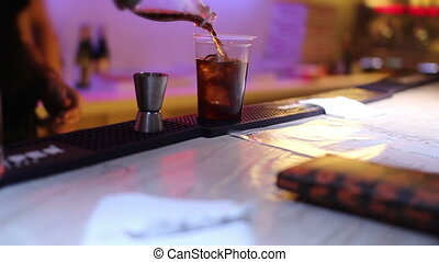 rum cola with ice - bartender prepare rum cola with ice
