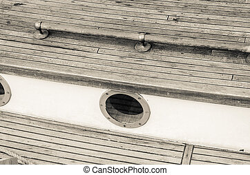 Close up of a deck of old sailing ship, sepia