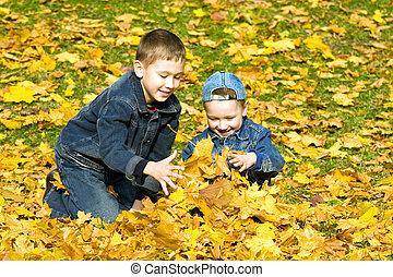 The boys in autumn park