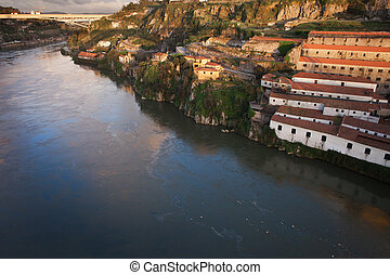 Sunset at Vila Nova de Gaia by Douro River in Portugal -...