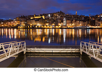 Porto by Night in Portugal - Old City of Porto skyline by...