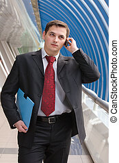 Businessman talking on phone - Young business man talking on...