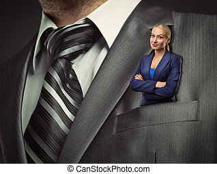 Small businesswoman in suit pocket - Small blond...