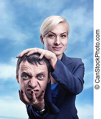 Woman with man's head in her hand - A psychic with man's...