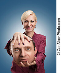Woman with mans head in her hand - Happy analyst with...