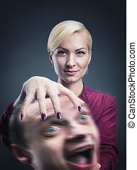 Woman with mans head in her hand - Serious psychic with...