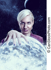 Woman holding a planet - Mystic fortune teller woman holding...