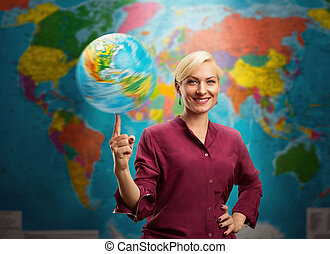 Woman with a globe - Travel agent woman with a globe against...
