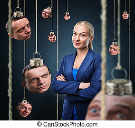 Woman with mans head hanging - Confident businesswoman with...