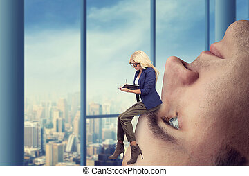 Woman on the man's face - Businesswoman analyst sits on the...