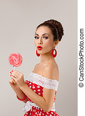 Funny Woman Holding Two Red Lollipops. Pin-up retro style.
